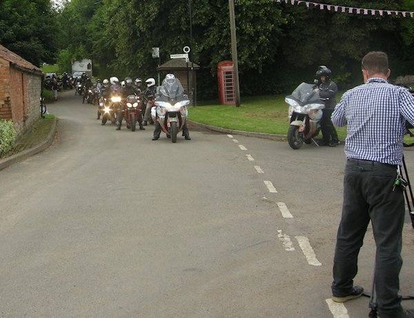 BBC camera man, as the convoy leaves the village