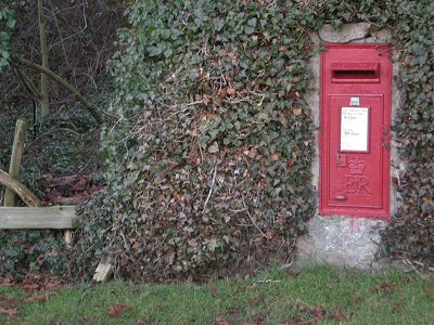 Maplebeck post box situated in a boundary wall